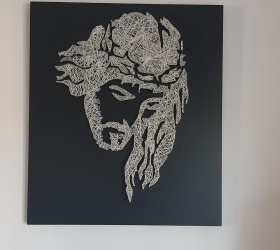 Wooden panel drawn with nails and strings